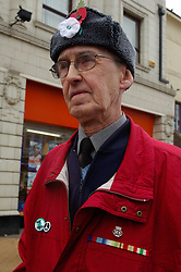 Veteran wearing red and white poppies; Whitley Bay; Armistice Day; Nov 2006 UK