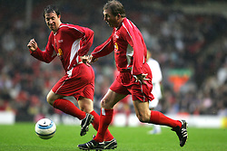 LIVERPOOL, ENGLAND - SUNDAY MARCH 27th 2005: Liverpool Legends' dream attack... Kenny Dalglish and Robbie Fowler attack the Celebrity XI goal during the Tsunami Soccer Aid match at Anfield. (Pic by David Rawcliffe/Propaganda)