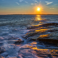 Rhode Island seascape photography image of a Beavertail State Park sunset across the Narragansett Bay in Rhode Island.<br /> <br /> Beavertail State Park seascape photography photos are available as museum quality photo, canvas, acrylic, wood or metal prints. Wall art prints may be framed and matted to the individual liking and New England interior design projects decoration needs.<br /> <br /> Good light and happy photo making!<br /> <br /> My best,<br /> <br /> Juergen