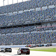 Drivers wait to enter the track during the 57th Annual NASCAR Coke Zero 400 practice session at Daytona International Speedway on Friday, July 3, 2015 in Daytona Beach, Florida.  (AP Photo/Alex Menendez)