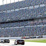 Drivers wait to enter the track during the 57th Annual NASCAR Coke Zero 400 practice session at Daytona International Speedway on Friday, July 3, 2015 in Daytona Beach, Florida.  (AP Photo/Alex Menendez)