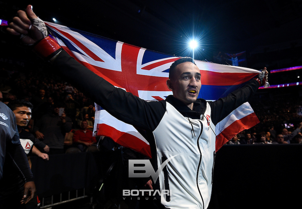 TORONTO, CANADA - DECEMBER 10:  Max Holloway prepares to enter the Octagon before his interim UFC featherweight championship bout against Anthony Pettis during the UFC 206 event inside the Air Canada Centre on December 10, 2016 in Toronto, Ontario, Canada. (Photo by Jeff Bottari/Zuffa LLC/Zuffa LLC via Getty Images)