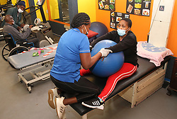 South Africa - Durban - 30 September 2020 - Gym instructor Gina Gabriel helps disabled Zanele Cebekhulu at the gym in South beach<br /> Picture: Doctor Ngcobo/African News Agency(ANA)