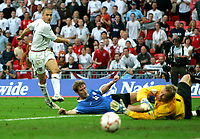 Photo: Tom Dulat.<br /> England v Estonia. UEFA European Championships Qualifying. 13/10/2007.<br /> Joe Cole of England missed another shot on target. Raio Piiroja of Estonia blocked the ball.