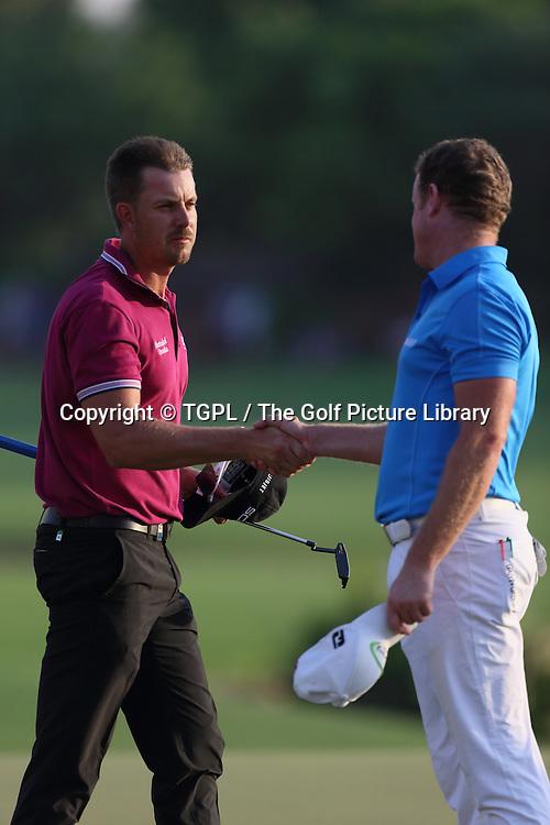 Henrik STENSON (SWE) and Jamie DONALDSON (WAL) during second round DP World Tour Championship 2013,Jemeirah Golf Estates, Dubai,UAE.