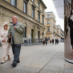 Warsaw, Poland - May, 2009 - Along Ul Krakowskie Przedmiescie , across the street from Warsaw University, pedestrians mingle alongside vintage photographic installations..Photo © Susana Raab 2009