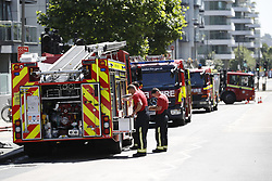 © Licensed to London News Pictures. 27/06/2018. London, UK. The scene at a tower block fire in Battersea, South London currently being attended by 58 firefighters. The fire is reported to have started on a third floor balcony before working its way up the outside of the building. Photo credit: Peter Macdiarmid/LNP