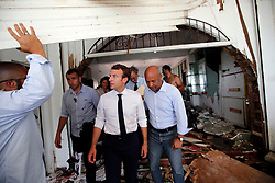 France's President Emmanuel Macron looks on destroyed building during his visit in the French Caribbean islands of St. Martin , Tuesday, Sept. 12, 2017. Macron is in the French-Dutch island of St. Martin, where 10 people were killed on the French side and four on the Dutch. Photo by Christophe Ena/Pool/ABACAPRESS.COM