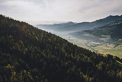 THEMENBILD - Nadelbaumwald und Burg- silhouetten mit dem Salzachtal am frühen Morgen, aufgenommen am 26. Juli 2019 in Piesendorf, Österreich // Coniferous forest and mountain silhouettes with the Salzach valley in the early morning, Piesendorf, Austria on 2019/07/26. EXPA Pictures © 2019, PhotoCredit: EXPA/ JFK