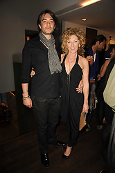 KELLY HOPPEN and Adam Meiklejohn at a private view of Sacha Jafri's paintings entitled 'London to India' held in aid of The Elephant Family charity at 23 Macklin Street, Covent Garden, London on 3rd June 2010.