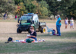 "© Licensed to London News Pictures. 20/09/2020. London, UK. Police patrol Richmond Park in South West London in a 4x4 vehicle on the first weekend of the ""Rule of Six"" as members of the public enjoy a picnic and walk in the fine weather. Gatherings of over six people have been banned by the Government after a spike in coronavirus cases. Health Minister Matt Hancock has announced that people with coronavirus who don't self-isolate could be fined up to £10,000 and Prime Minister Boris Johnson has said that the UK was heading for a second wave.  Photo credit: Alex Lentati/LNP"