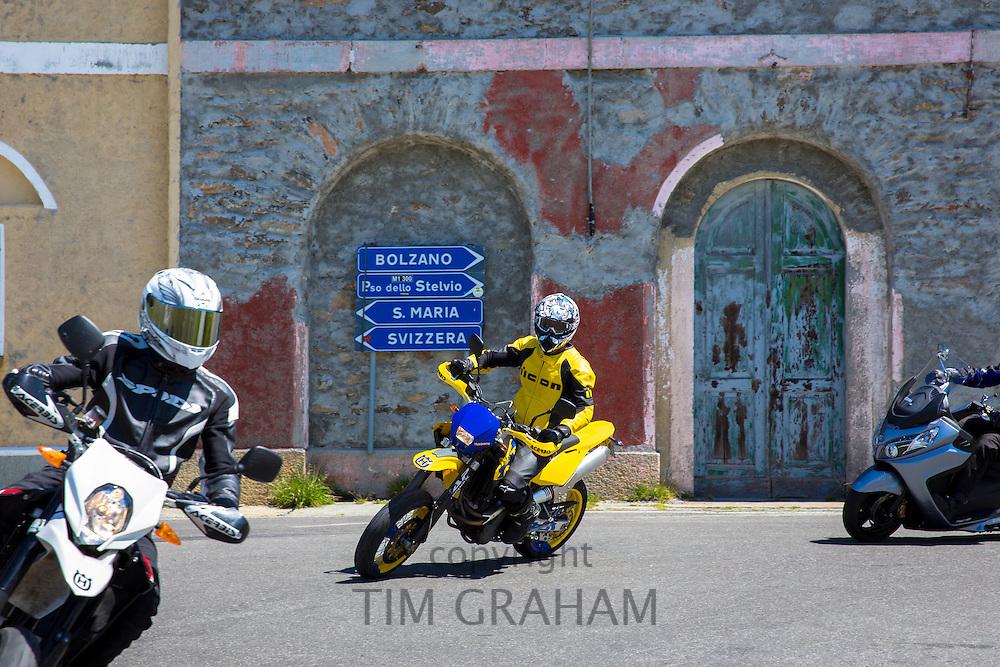 Motorcyclists on Honda Acerbis motorbikes drive The Stelvio Pass, Passo dello Stelvio, Stilfser Joch, to Bormio, Italy