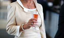 A female racegoer enjoys a drink during day two of Royal Ascot at Ascot Racecourse.