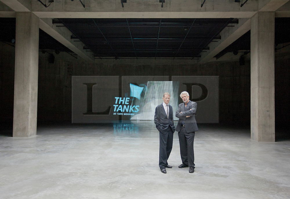 © Licensed to London News Pictures. 16/07/2012.  LONDON, UK. Sir Nicholas Serota (L), director of the Tate and Chris Dercon, director of the Tate Modern, stand in one of the gallery's new Tank Room exhibition spaces in London today (16/07/12). The new rooms, unveiled today mark the first phase of the Tate Modern Project and the beginning of the 15 week 'Art in Action' festival. Photo credit: Matt Cetti-Roberts/LNP