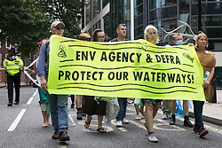 Extinction Rebellion activists arrive outside the Department for Environment, Food and Rural Affairs (Defra) to protest against the pollution of the UK's waterways on 5th August 2021 in London, United Kingdom. The activists were highlighting pollution of rivers by water companies and farms and the failure of the Environment Agency and Defra to protect waterways and to prosecute offenders.