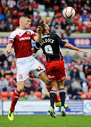 Swindon Defender Darren Ward (ENG) and Bristol City Forward Sam Baldock (ENG) compete in the air during the second half of the match - Photo mandatory by-line: Rogan Thomson/JMP - Tel: 07966 386802 - 21/09/2013 - SPORT - FOOTBALL - County Ground, Swindon - Swindon Town v Bristol City - Sky Bet League 1.