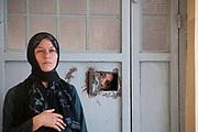 Herat Women's prison. Warden and prisoner looking through spyhole.