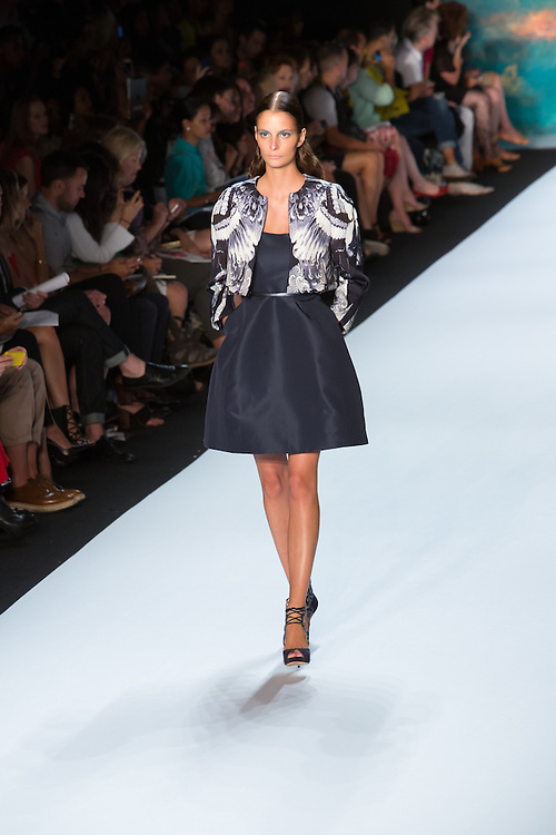 Little black dress with an A-line skirt and a black, gray and white print jacket. By Monique Lhuillier at Spring 2013 Fall Fashion Week in New York.