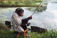 Fred the chimp seen fishing at Longleat Safari Park, Wiltshire, England. Photographed by Terry Fincher