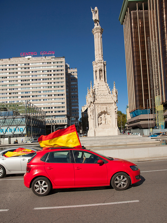 MADRID, SPAIN - OCTOBER 12: A car drives by Columbus statue at Plaza de Colón (Clumbus Square) during Spain's National Day on October 12, 2020 in Madrid, Spain. This year the traditional Spanish National Day military parade alongside the Paseo de la Castellana in Madrid has been canceled due to the Covid-19 pandemic and replaced by a more discreet event at the Royal Palace. (Photo by Miguel Pereira/Getty Images)