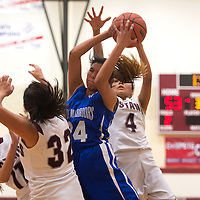 011113      Cayla Nimmo<br /> <br /> Navajo Pine Lady Warrior Krystal Nelson (24) catches a rebounded ball surrounded by three Ramah Mustang players during the Tuesday night game at Ramah High School.