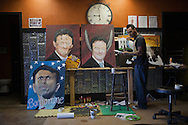 Bobby Pirtre working on a new painting, his way of expressing his angst against the BP oil spill. Tony Hayward and Bobby Jindal are subjects to his satirical work.