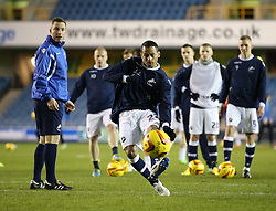 Millwall's DJ Cambell warms up for his first game at The Den watched by team coach Neil Harris and team mates - Photo mandatory by-line: Robin White/JMP - Tel: Mobile: 07966 386802 28/01/2014 - SPORT - FOOTBALL - The Den - Millwall - Millwall v Sheffield Wednesday - Sky Bet Championship