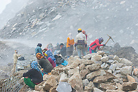 Nepalese workers, Rohtang Pass in Himachal Pradesh, India. The 13,000 foot pass, near Manali, in the Pir Panjal Range of the Himalayas connects the Kullu Valley with the Lahaul and Spiti Valleys.