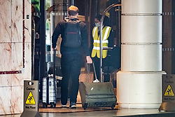 © Licensed to London News Pictures. 16/02/2021. London, UK. A passenger arrives at the Radisson Hotel near Heathrow Airport, where travellers from red list countries are being held in quarantine. New quarantine measures have been introduced for travellers form red list countries, who will be required to isolate for ten days in a hotel at a cost of £1,750 per person. Photo credit: Ben Cawthra/LNP