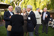 Members of the San Jose State University Heritage Society enjoy cocktails and conversations during an event at San Jose State University President Mohammad Qayoumi's home in San Jose, California, on June 6, 2014. (Stan Olszewski/SOSKIphoto)