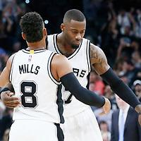 04 April 2017: San Antonio Spurs guard Jonathon Simmons (17) congratulates San Antonio Spurs guard Patty Mills (8) during the San Antonio Spurs 95-89 OT victory over the Memphis Grizzlies, at the AT&T Center, San Antonio, Texas, USA.