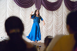 Young girl performing a dance on stage celebrating Diwali; Festival of Light,