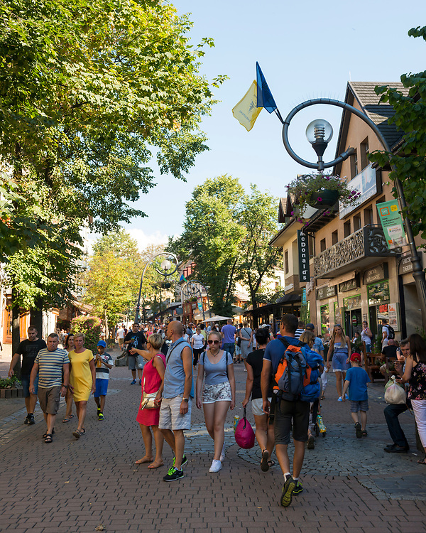 Pedestrains walk in the popular tourist town of Zakopane, located at the base of the Tatra Mountains in southern Poland.