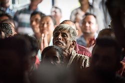 14 September 2018, Damak, Nepal: Rev. A group of refugees listen attentively as camp secretary Tikaram Rasaily, himself a refugee, speaks during a visit of Lutheran World Federation general secretary Rev. Dr Martin Junge to the Beldangi refugee camp in the Jhapa district of Nepal, which hosts more than 5,000 Bhutanese refugees. For the past two years, the refugees themselves oversee monitoring, maintenance and governance of the camp.