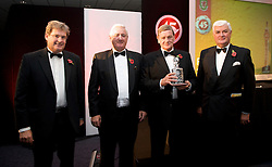 CARDIFF, WALES - Wednesday, November 11, 2009: Wales' Gary Sprake (ex-Leeds United and Wales goalkeeper 1964-1974) receives his special award from SA Brains' Chairman John Rhys, President Phil Pritchard and General Secretary David Collins during the Football Association of Wales Player of the Year Awards hosted by Brains SA at the Cardiff City Stadium. (Pic by David Rawcliffe/Propaganda)