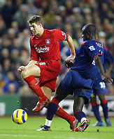 14/12/2004 - FA Barclays Premiership - Liverpool v Portsmouth - Anfield, Liverpool<br /> Liverpool's Steven Gerarrd jumps over the tackle from Portsmouth's Amdy Faye<br /> Photo:Jed Leicester/Digitalsport
