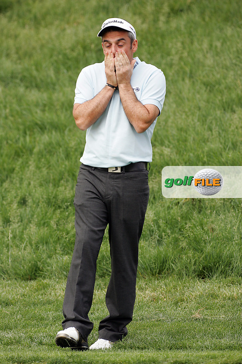 Paul McGinley rues his first chip into the 18th green in the Open de Espana in Madrid...Photo NEWSFILE/Eoin Clarke.(Photo credit should read Eoin Clarke/NEWSFILE)....This Picture has been sent you under the condtions enclosed by:.Newsfile Ltd..The Studio,.Millmount Abbey,.Drogheda,.Co Meath..Ireland..Tel: +353(0)41-9871240.Fax: +353(0)41-9871260.GSM: +353(0)86-2500958.email: pictures@newsfile.ie.www.newsfile.ie.FTP: 193.120.102.198..