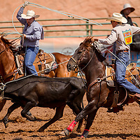 Team ropers Wyatt Bray and Zant Lewis run down their calf in the Best of the Best rodeo Friday at Red Rock Park in Gallup.
