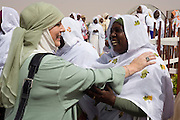 After a flight from the Sudanese capital Khartoum, British Muslim activist, TV broadcaster and journalist, Yvonne Ridley is greeted by women of Darfur on the tarmac of Al-Fashir airport. She and a delegation hosted by British peer Lord Ahmed, she is here to attend the first-ever international Conference on Womens' Challenge in Darfur, hosted by the govenor in his own compound.