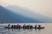 Women rowing Dragon Boat on Slocan Lake, New Denver, Slocan Valley, West Kootenay, British Columbia, Canada