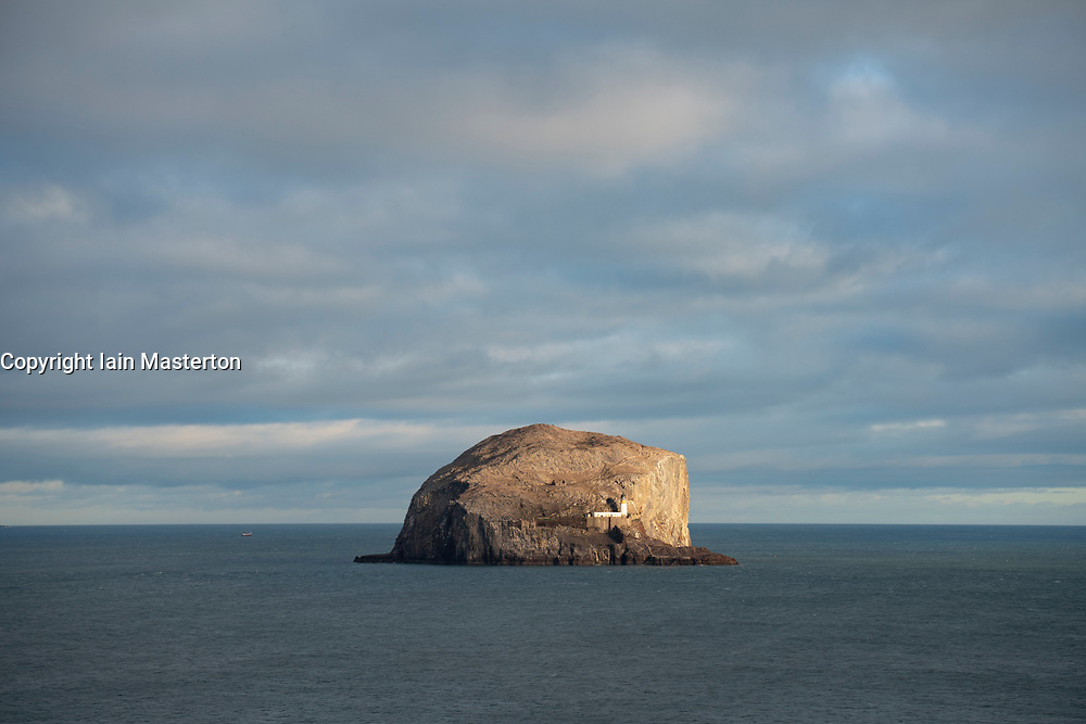 View of sun glinting off Bass Rock in Firth of Forth, Scotland UK