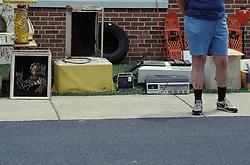 church flea market rummage sale  man in  blue bermuda shorts.