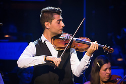 Syrian violinist Rami Basisah performs with The Bournemouth Symphony Orchestra, conducted by Pete Harrison, at Classic FM Live, at the Royal Albert Hall in London. The concert was part of Classic FM's 25th Birthday celebrations. Picture date: Tuesday September 19th, 2017. Photo credit should read: Matt Crossick/ EMPICS Entertainment.