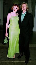 Designer PHILIP TREACY and model KAREN ELSEN at a dinner in London on 1st July 1997.LZW 13