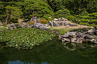 Ritsurin Pond Garden - Ritsurin Garden is a landscape garden in Takamatsu  built by the local feudal lords during the Edo Period. Considered one of the finest gardens in Japan.  Ritsurin features many ponds, hills and pavilions set in front of wooded Mt. Shiun which serves as a background and example of borrowed scenery and Japanese gardening design.
