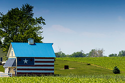 Barn with a unique rendition of the American Flag painted on the side featuring 3 stars