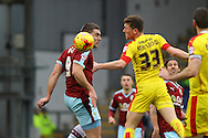Sam Vokes of Burnley and Richard Smallwood of Rotherham United look to head the ball. Skybet football league Championship match, Burnley v Rotherham United at Turf Moor in Burnley, Lancs on Saturday 20th February 2016.<br /> pic by Chris Stading, Andrew Orchard sports photography.