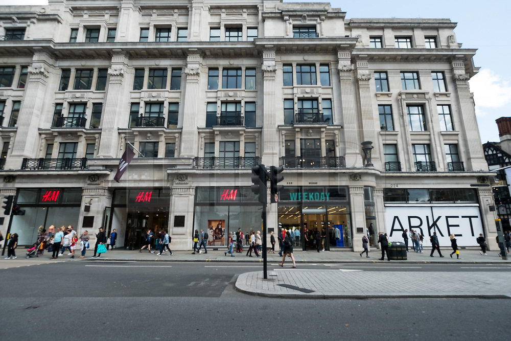 © Licensed to London News Pictures. 18/08/2017. London, UK. The new opening H&M group's first Weekday clothing store in Regent Street. is placed between H&M and Arket stores. Weekday is know for its offerings and minimalist styles, with 27 stores throughout Europe. The store is next to the H&M Arket lifestyle store. Photo credit: Ray Tang/LNP