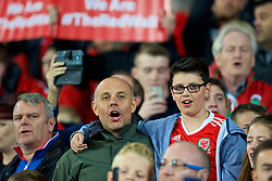 CARDIFF, WALES - Monday, October 9, 2017: Two Wales supporters sing the national anthem before the 2018 FIFA World Cup Qualifying Group D match between Wales and Republic of Ireland at the Cardiff City Stadium. Jason Mohammad. (Pic by Paul Greenwood/Propaganda)