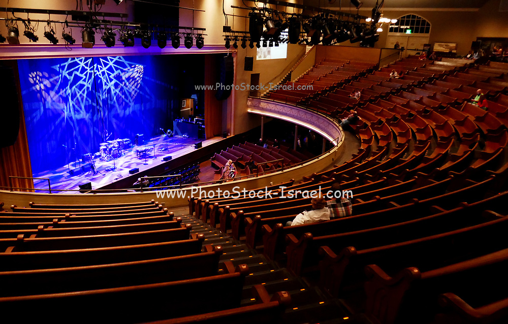 Seats and stage at the Ryman Auditorium former home of the Grand Ole Opry country music radio Nashville Tennessee USA